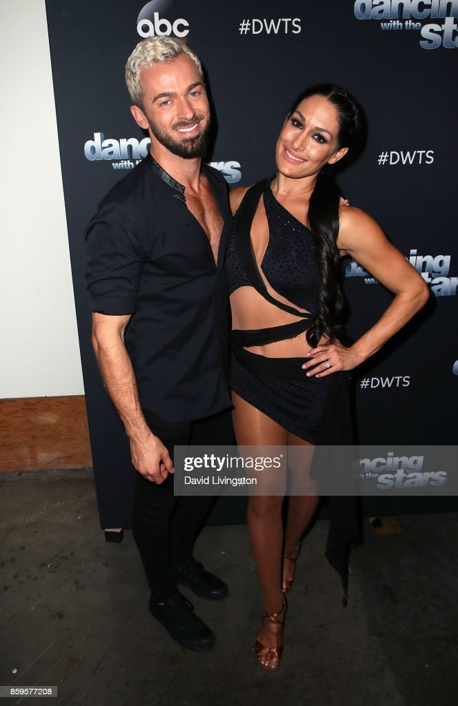 Professional wrestler Nikki Bella (R) and dancer Artem Chigvintsev attend 'Dancing with the Stars' season 25 at CBS Televison City on October 9, 2017 in Los Angeles, California.
