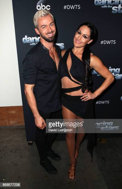 Professional wrestler Nikki Bella and dancer Artem Chigvintsev attend Dancing with the Stars season 25 at CBS Televison City on October 9 2017 in Los...