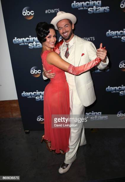 Professional wrestler Nikki Bella and dancer Artem Chigvintsev pose at Dancing with the Stars season 25 at CBS Televison City on October 23 2017 in...