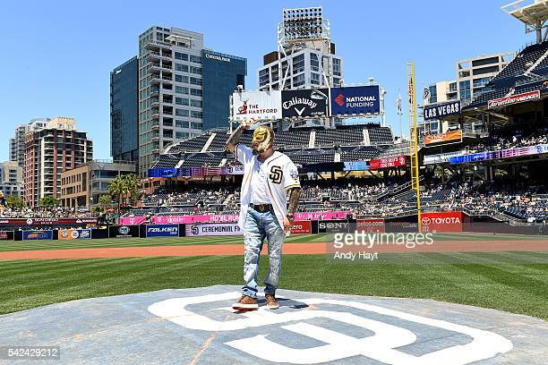Professional wrestler Rey Mysterio prepares to deliver a first pitch prior to the game between the San Diego Padres and the Washington Nationals at...