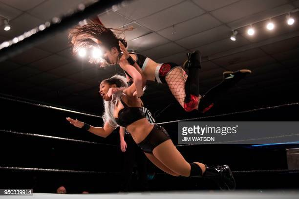 TOPSHOT Professional Wrestler Robin Reed is thrown to the mat by MCW Women's Champion Brittany Blake during the Tribute to The Legends match in Joppa...