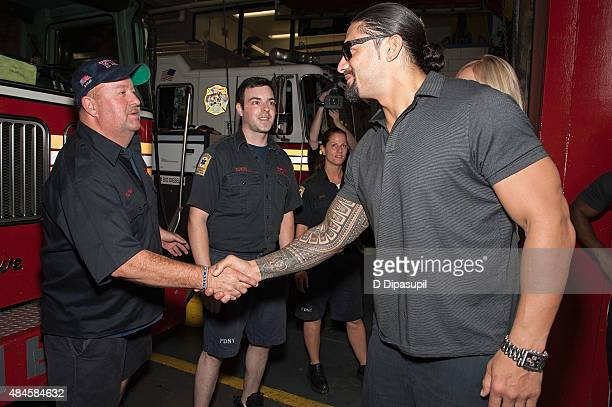 Professional wrestler Roman Reigns attends WWE Answer The Call Tour Visits Engine 39/Ladder 16 on August 20 2015 in New York City