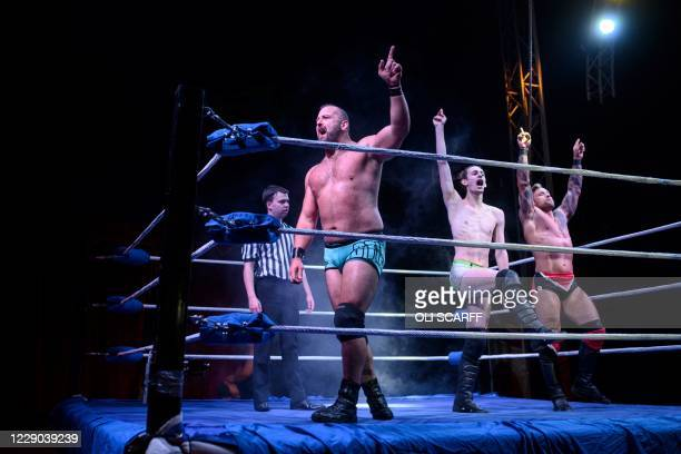 Professional wrestlers 'Action Man' Stixx , Tyler Owens and Colt Miles of Team Megaslam celebrate overall victory during an evening of wrestling...