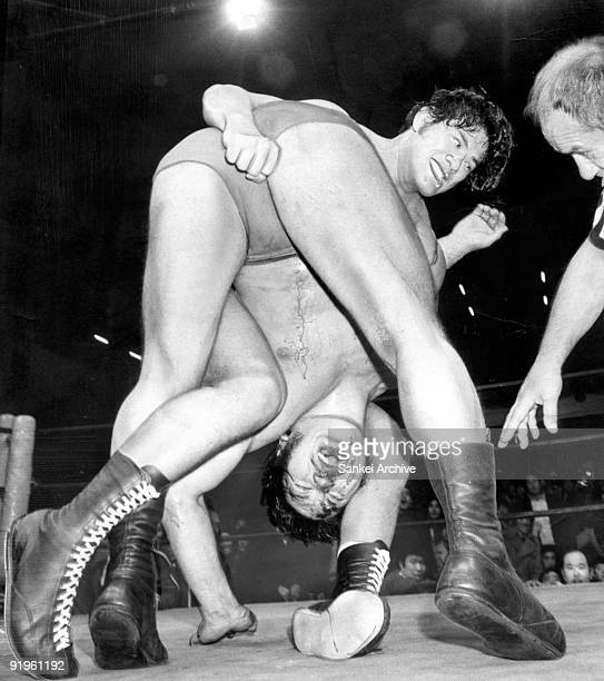 Professional wrestlers Antonio Inoki and Strong Kobayashi compete in the NWF World Heavyweight Title Match between Antonio Inoki and Strong Kobayashi...