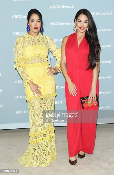 Professional wrestlers Brie Bella and Nikki Bella attend the 2018 NBCUniversal Upfront presentation at Rockefeller Center on May 14 2018 in New York...