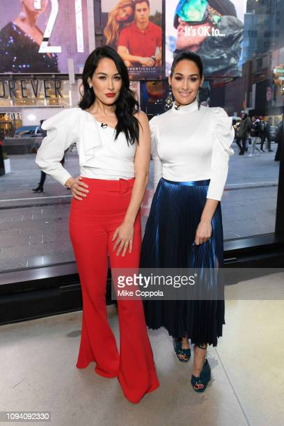 Professional Wrestlers Brie Bella and Nikki Bella visit 'Extra' at The Levi's Store Times Square on January 14 2019 in New York City