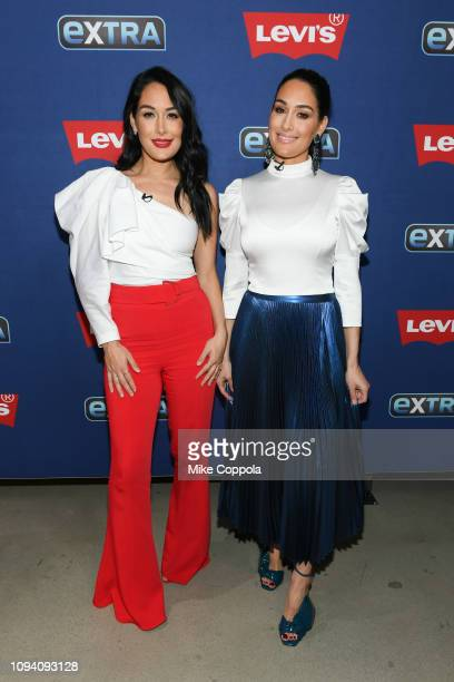 Professional Wrestlers Brie Bella and Nikki Bella visit Extra at The Levi's Store Times Square on January 14 2019 in New York City