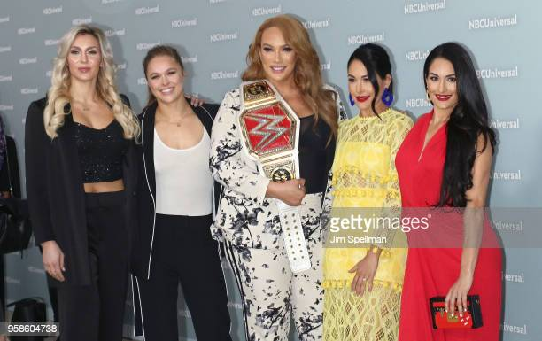 Professional wrestlers Charlotte Flair Ronda Rousey Nia Jax Brie Bella and Nikki Bella attend the 2018 NBCUniversal Upfront presentation at...