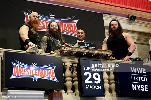 WWE professional wrestlers Erick Rowan and Bray Wyatt Global Head of Capital Markets at NYSE Garvis Toler and WWE professional wrestler Braun...
