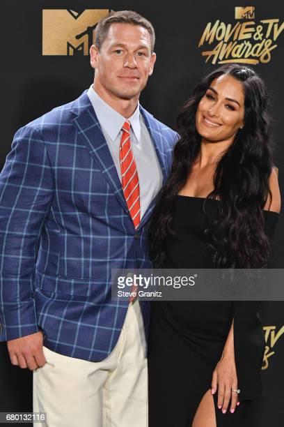 Professional wrestlers John Cena and Nikki Bella poses in the press room at the 2017 MTV Movie and TV Awards at The Shrine Auditorium on May 7 2017...
