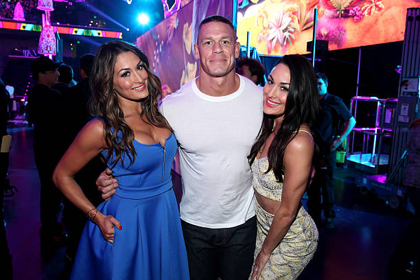 Professional wrestlers Nicole GarciaColace John Cena and Brianna GarciaColace backstage at Nickelodeon's 27th Annual Kids' Choice Awards held at USC...