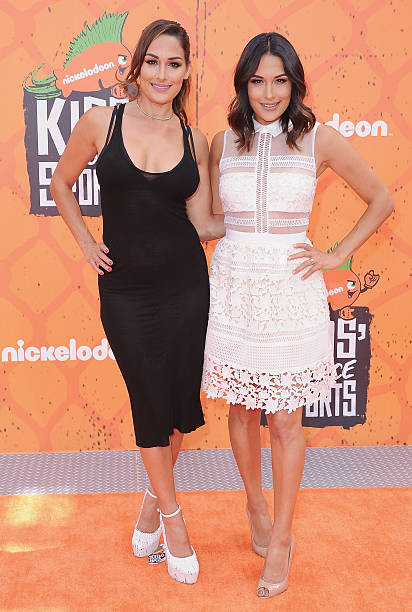 Professional wrestlers Nikki Bella and sister Brie Bella arrive at Nickelodeon Kids' Choice Sports Awards 2016 at UCLA's Pauley Pavilion on July 14...