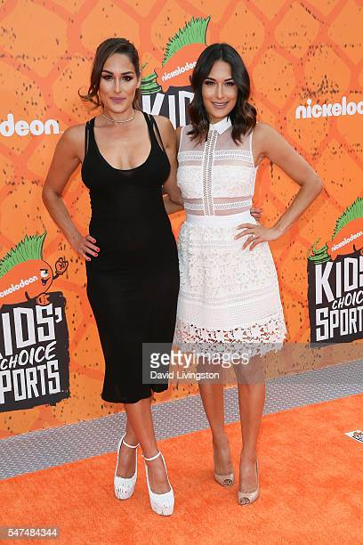 Professional wrestlers Nikki Bella and sister Brie Bella arrive at the Nickelodeon Kids' Choice Sports Awards 2016 at the UCLA's Pauley Pavilion on...
