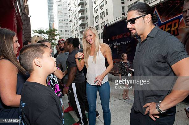 Professional wrestlers Roman Reigns Summer Rae Xavier Woods and Jimmy Uso attend WWE Answer The Call Tour Visits Engine 39/Ladder 16 on August 20...