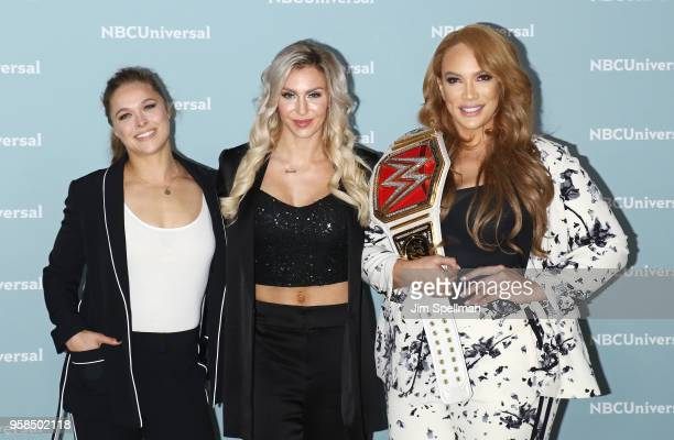 Professional wrestlers Ronda Rousey Charlotte Flair and Nia Jax attend the 2018 NBCUniversal Upfront presentation at Rockefeller Center on May 14...