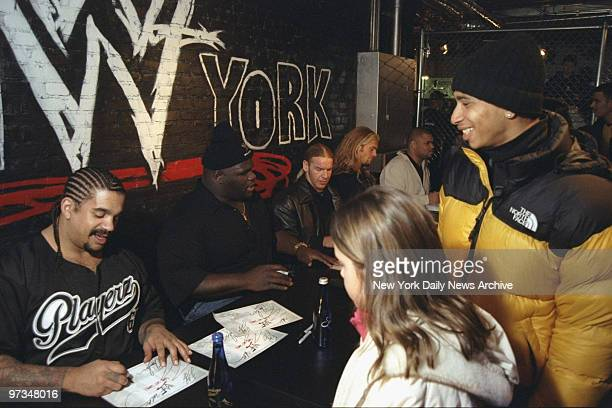 Professional wrestlers The Godfather, Mark Henry, Edge, Christian and D'Lo Brown sign autographs for fans at the Royal Rumble party at WWF New York...