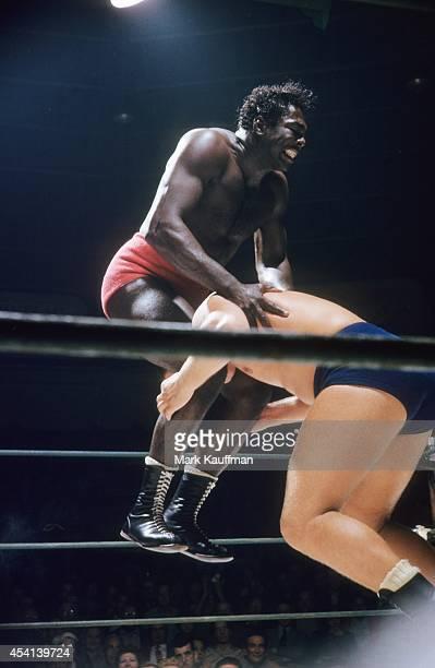 Bobo Brazil in action scissor hold vs Gene Kiniski during match at Ocean Park Arena Santa Monica CA CREDIT Mark Kauffman