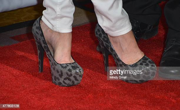 Professional wrestling personality Alicia Webb shoe detail arrives at the Raising the Stakes for Cerebral Palsy Celebrity Poker Tournament at Planet...