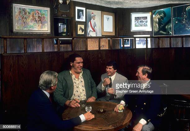 Portrait of Andre the Giant Roussimoff with Vince McMahon Sr Vince McMahon Jr and Jimmy Weston at Jimmy Weston's Restaurant New York NY CREDIT...
