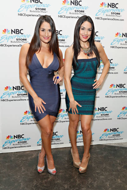 Professional wrestling tag team Nikki Bella and Brie Bella visit the NBC Experience Store on July 26 2013 in New York City