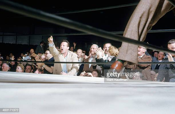 View of fans ringside reacting to action during match at Hollywood Legion Stadium Los Angeles CA CREDIT Mark Kauffman