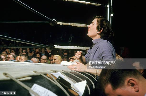 View of female fan threatening with clenched fist from ringside during match at Hollywood Legion Stadium Los Angeles CA CREDIT Mark Kauffman