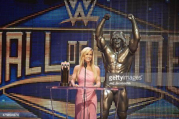 WWE Hall of Fame Induction Dana Warrior at podium with Ultimate Warrior statue behind her during ceremony at SAP Center San Jose CA CREDIT Jed...