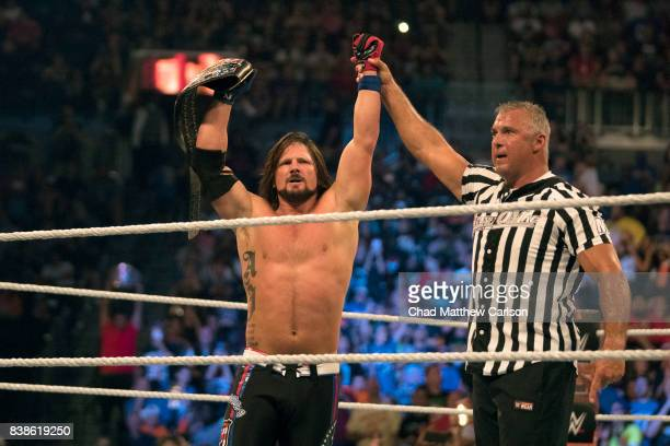 WWE SummerSlam AJ Styles victorious holding belt after match vs Kevin Owens at Barclays Center Special guest referee Shane McMahon Brooklyn NY CREDIT...