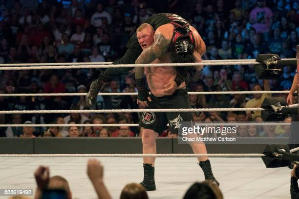 WWE SummerSlam Brock Lesnar in action holding up vs Roman Reigns during match at Barclays Center Brooklyn NY CREDIT Chad Matthew Carlson