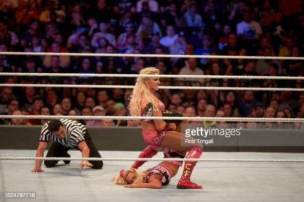 WWE SummerSlam Carmella in action vs Charlotte Flair during match at Barclays Center Brooklyn NY CREDIT Rob Tringali