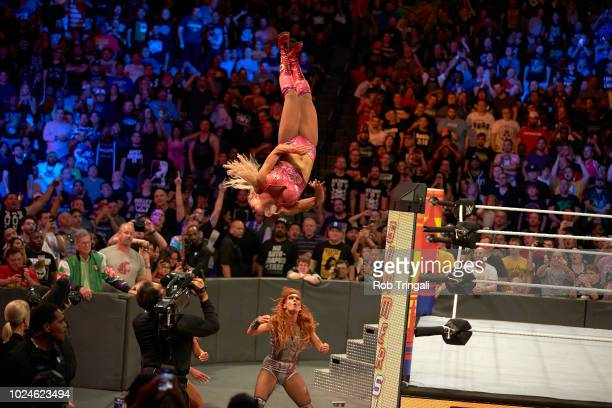 WWE SummerSlam Charlotte Flair in action in midair vs Becky Lynch during event at Barclays Center Brooklyn NY CREDIT Rob Tringali