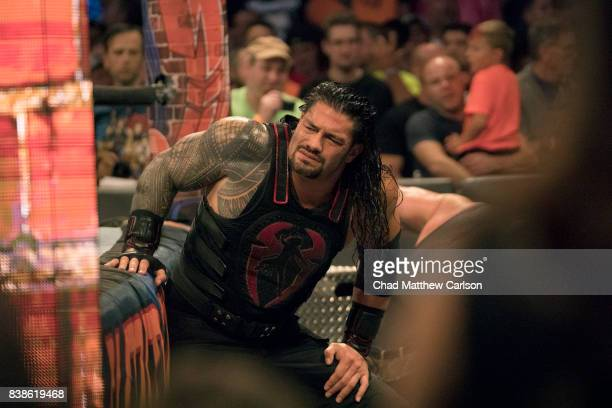 WWE SummerSlam Roman Reigns out of ring during injury vs Brock Lesnar during match at Barclays Center Brooklyn NY CREDIT Chad Matthew Carlson