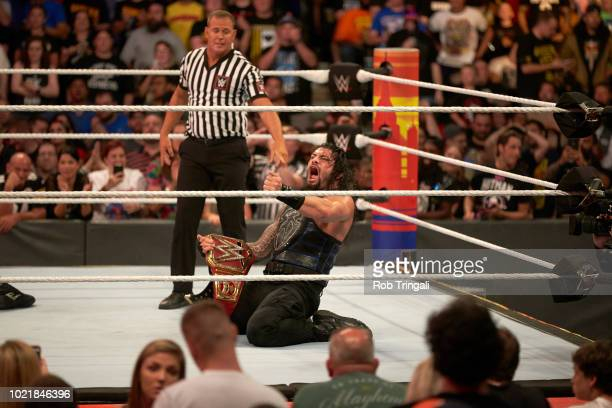 WWE SummerSlam Roman Reigns victorious with belt during Universal Championship match vs Brock Lesnar at Barclays Center Brooklyn NY CREDIT Rob...