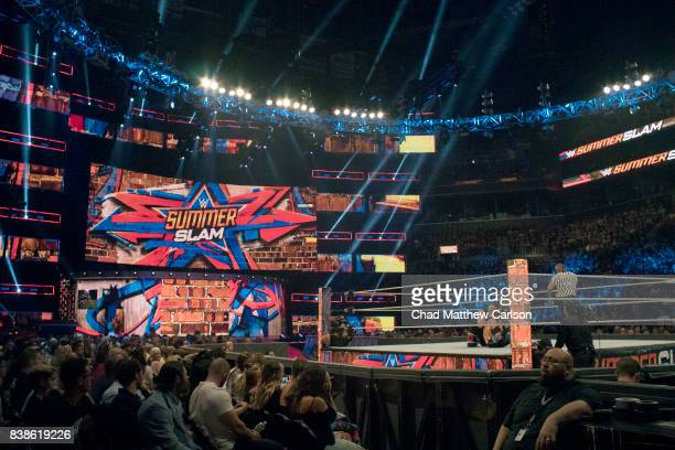 WWE SummerSlam View of Kevin Owens in action vs AJ Styles during match at Barclays Center View of scoreboard in background that reads SUMMER SLAM...
