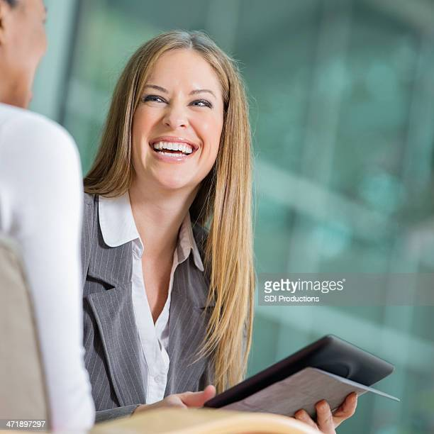 professional young businesswoman interviewing someone for job opening - recruiter stock pictures, royalty-free photos & images