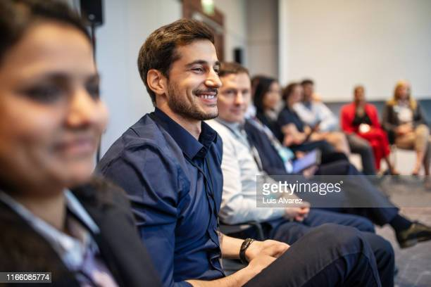 professionals attending a seminar in convention center - launch event stock pictures, royalty-free photos & images