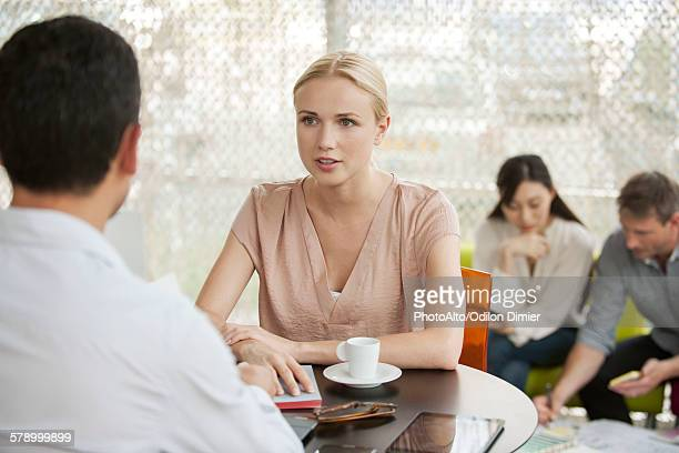 Professionals having casual meeting in cafe