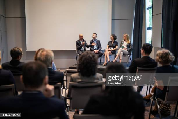 professionals in convention center during seminar - conference stock pictures, royalty-free photos & images