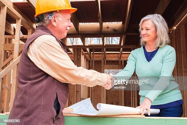 Architekt, Auftragnehmer, Inhaber, Mann und Frau auf Baustelle
