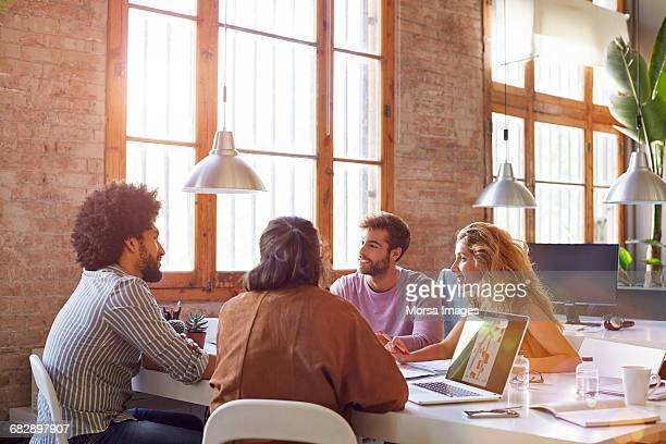 Professionals sitting at desk in office