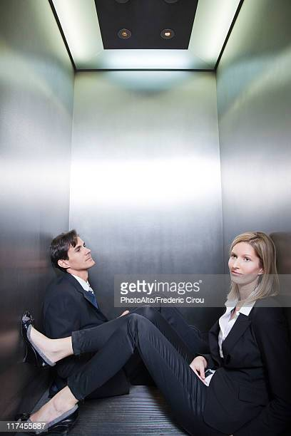 Professionals stuck in elevator together