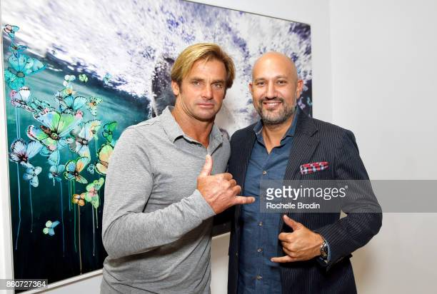 Professionnal sufer Laird Hamilton and gallery owner Steph Sebbag attend the Michael Muller and Sage Vaughn exhibit presented by Untitled Projects...