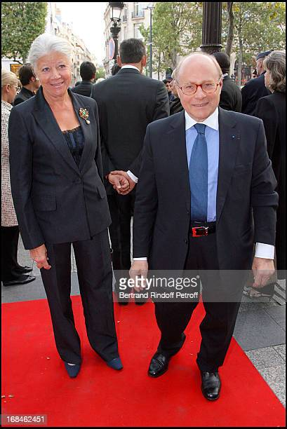 Professor Alain Pompidou and his wife at Premiere Of Film 'Faubourg 36' At Ugc Normandie In Benefit Of Claude Pompidou Foundation