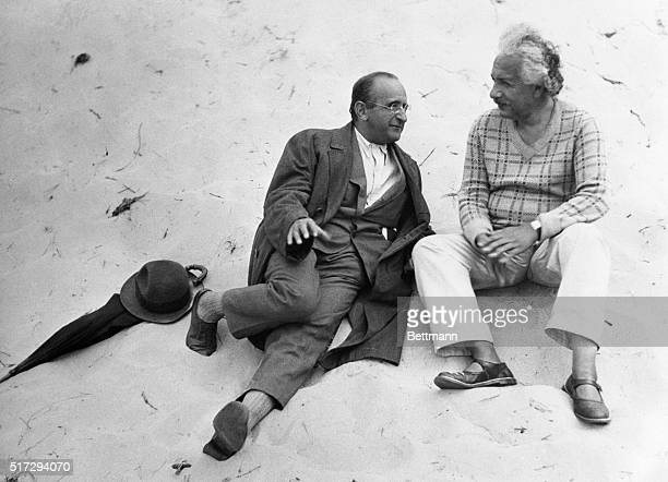 Professor Albert Einstein and his colleague Professor Walther Mayer of Vienna go into a little relaxing dialogue on the beach at CoqsurMer Belgium...