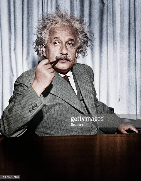 Professor Albert Einstein now exiled from Germany calmly smokes his pipe He is in the United States to give a series of lectures to advanced students...