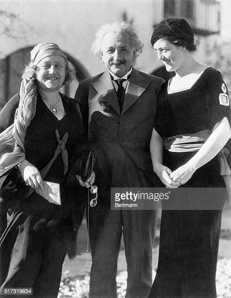 Professor Albert Einstein world famed mathematician and exponent of the 'fourth dimension' and relativity theories with Mrs Einstein and Gene Dennis...