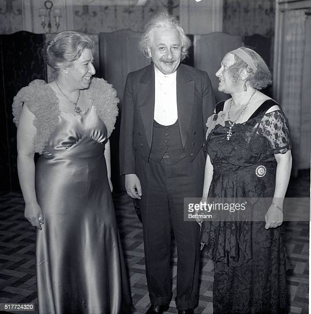 Professor Albert Einstein worldfamous mathematician and physicist with Mrs Einstein right and Mrs Theresa M Durlach president of the World Peaceways...