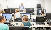 professor adult students having class computer