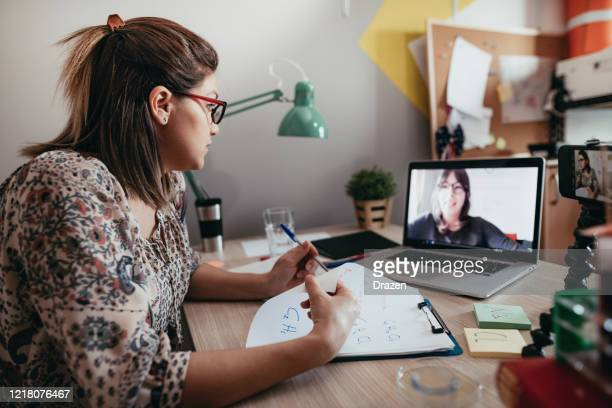 professor and student discussing topics over online class platform - advice stock pictures, royalty-free photos & images