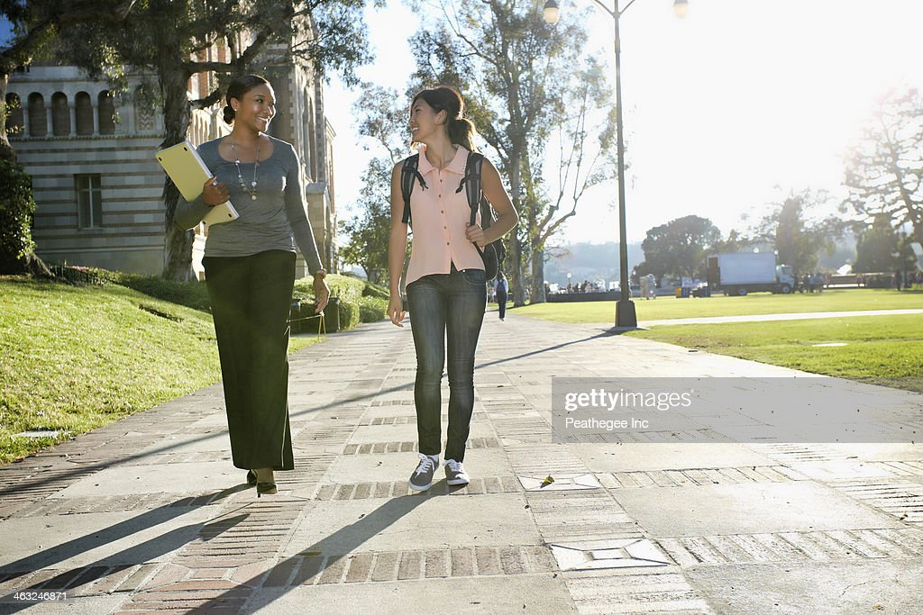 Professor and student walking on campus : Stock Photo